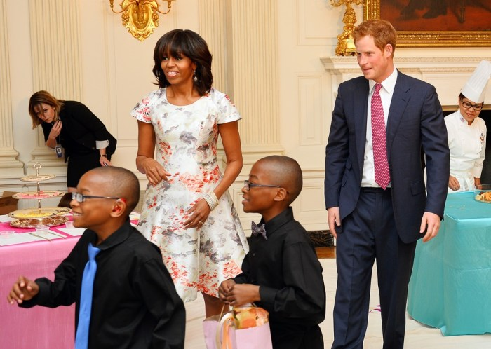 WASHINGTON, DC - MAY 09:  HRH Prince Harry and first lady Michelle Obama prepare to attend an event to honor military families at the White House duri...