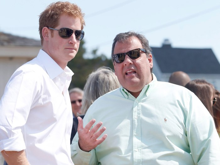 epa03700011 Britain's Prince Harry (L) listens to New Jersey Governor Chris Christie (R) in Mantoloking, New Jersey, USA, 14 May 2013, as the governor...