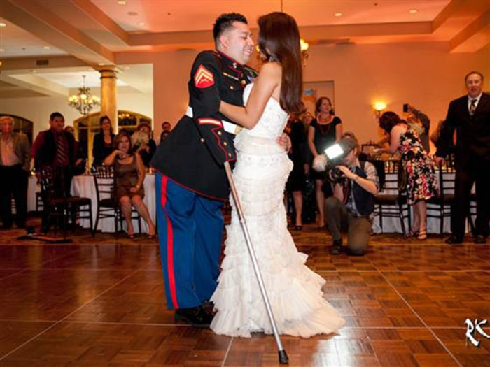 Juan Dominguez and his wife Alexis share a moment on the dance floor at their wedding last month.