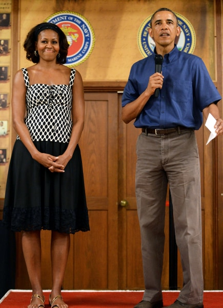 President Obama has updated his pleated dad pants look of a year ago with flat front pants and a short-sleeved button down shirt that he wore to a gathering with military members and their family in Hawaii during his annual Christmas vacation with his family.