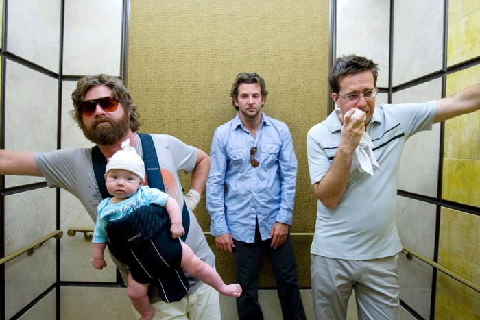 """In this film publicity image released by Warner Bros., Zach Galifianakis, left, Bradley Cooper, center, and  Ed Helms are shown in a scene from, """"The ..."""