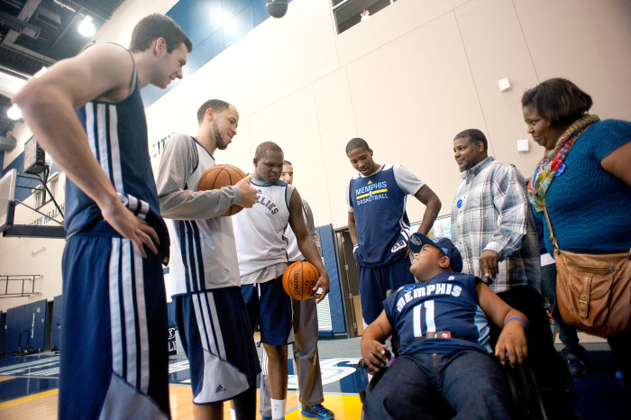 Memphis Grizzlies players surrounded Charvis Brewer before practice on Sunday. Charvis had all sorts of tips to share with them.