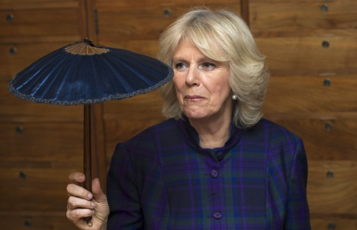 Britain's Camilla, Duchess of Cornwall, holds a mini parasol during a visit to the Fan Museum in Greenwich, south-east London on February 21, 2013. Th...