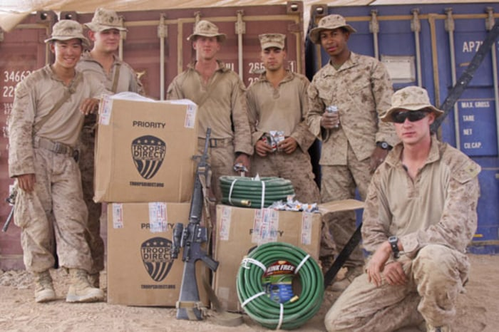 U.S. servicemen in Afghanistan distribute a shipment from Troops Direct, an online charity based in San Ramon, CA