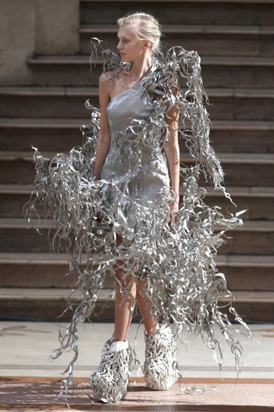 A model presents a creation by designer Iris van Herpen on July 1, 2013.