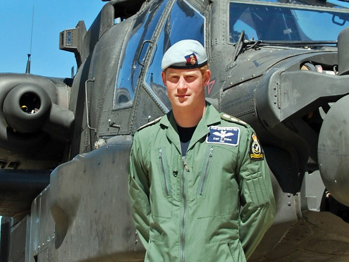 This photo released Friday July 5, 2013 shows Britain's Prince Harry posing in front of an Apache helicopter in an undisclosed location. Prince Harry ...