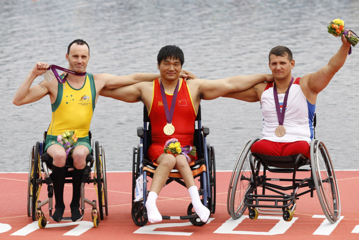 Russian Paralympic bronze medalist Aleksey Chuvashev (far right) will be part of the group of torchbearers leading up to Sochi in February of 2014.