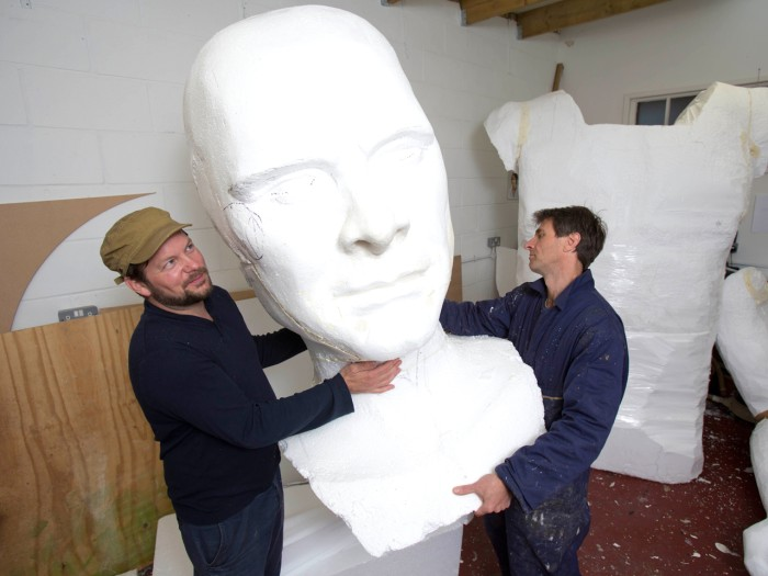 Artists Toby Crowther and Andy Billetto help construct the 12-foot statue of Pride and Prejudice's dashing hero, Mr. Darcy.