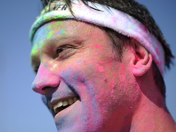 HANOVER, GERMANY - JULY 07:  A partcipiant covered in colored powder during the Color Run at the Hanover Fairgrounds on July 7, 2013 in Hanover, Germa...