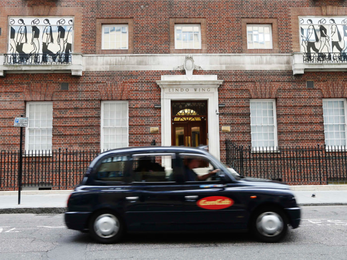 A taxi passes the Lindo Wing of St Mary's Hospital where Catherine, Duchess of Cambridge is due to give birth in London, June 19, 2013. Britain's Duch...