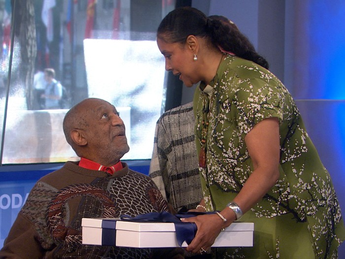 Actress Phylicia Rashad presents a special gift to her former co-star, Bill Cosby.