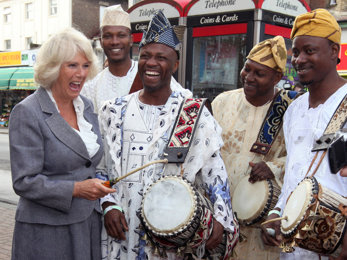 Camilla meets and laughs with African drummers in Croydon, Greater London on Sept. 20, 2012.