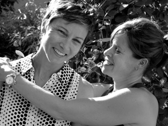 Jenna Wolfe hugs partner Stephanie Gosk