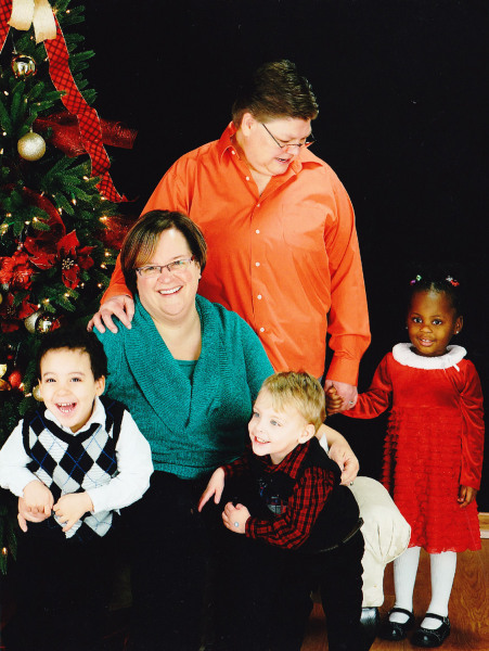 April DeBoer and Jane Rowse with their adopted children (from l-r) Nolan, Jacob and Ryanne.