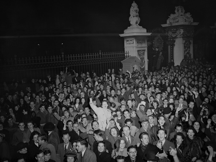 A jubilant crowd mass around the gates of Buckingham Palace, London, on Nov. 14, 1948, cheering the announcement of the birth of a prince to Princess ...