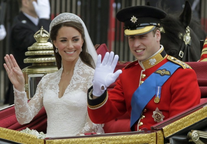 Image: Britain's Prince William and his wife Kate, Duchess of Cambridge, left, wave as they leave Westminster Abbey on their wedding day.