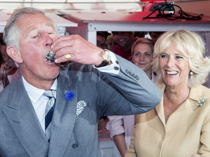UNSPECIFIED, UNITED KINGDOM - JULY 29:  Camilla, Duchess of Cornwall watches as Prince Charles, Prince of Wales tries some Oysters during a visit to T...