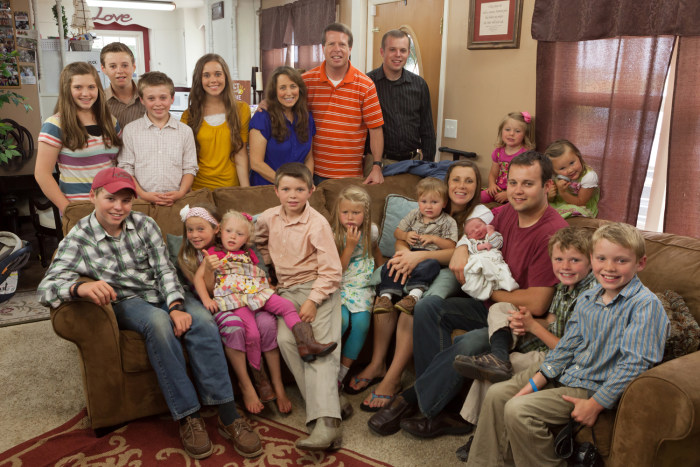 The whole Duggar family meets baby Marcus, who is in his father's arms.