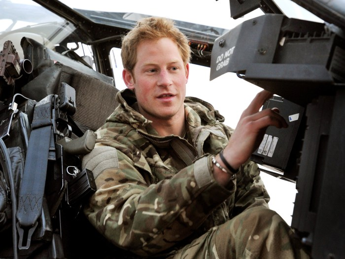 CAMP BASTION, AFGHANISTAN - DECEMBER 12:  In this image released on January 21, 2013, Prince Harry makes early morning checks as he sits on an Apache ...