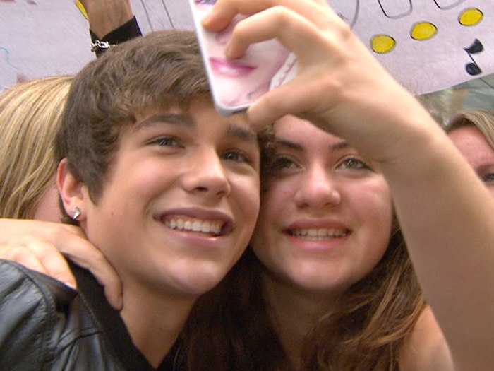 Mahone smiles for the camera with a fan.