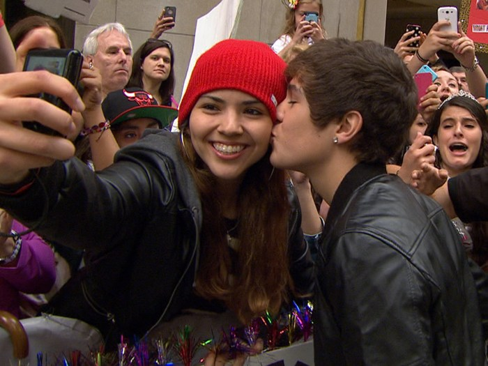 Mahone kisses one girl on her cheek.