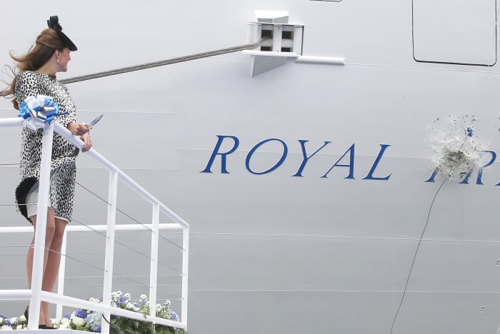 The Duchess of Cambridge names the Royal Princess with the traditional smashing of the champagne bottle.