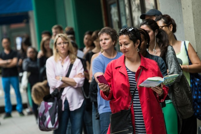 "NEW YORK, NY - JUNE 10:  Allison Smith, on vacation from Minnesota, waits in line to purchase a croissant-doughnut hybrid (known as a ""cronut"") outsid..."