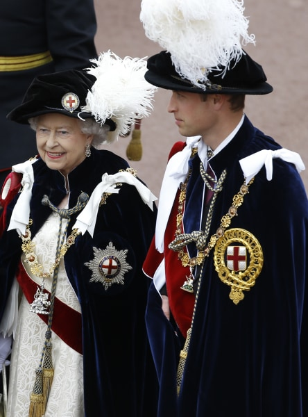 Britain's Queen Elizabeth II walks in procession with Prince William, right, in the annual Garter Ceremony at Windsor Castle, England, Monday, June 17...