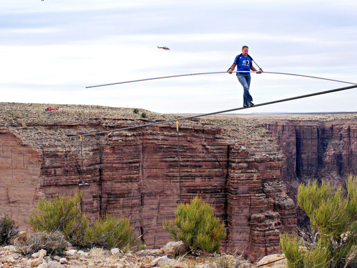 Nik Wallenda nears the end of his quarter mile high-wire walk. Wallenda said his faith helped him stay focused on making it to the other side.