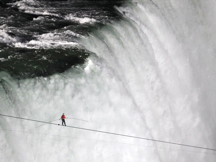 Tightrope walker Nik Wallenda walks the high wire from the U.S. side to the Canadian side over the Horseshoe Falls in Niagara Falls, Ontario, June 15,...