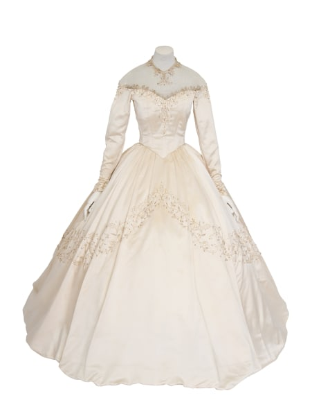 The gown Elizabeth Taylor wore for her first wedding was auctioned off Wednesday for more than twice than the highest estimate.