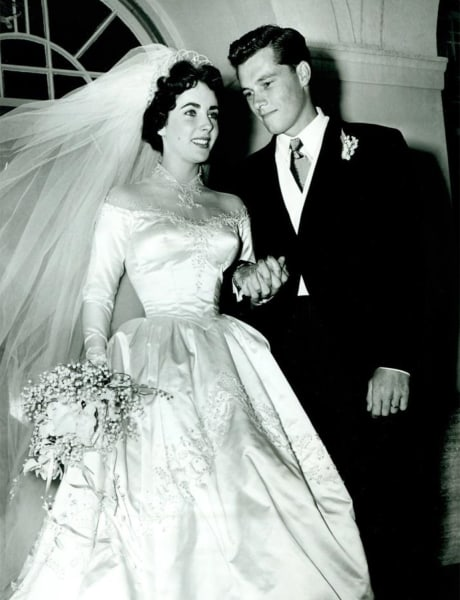 "Elizabeth Taylor, 18, shown at her 1950 wedding to hotel heir Conrad ""Nicky"" Hilton."