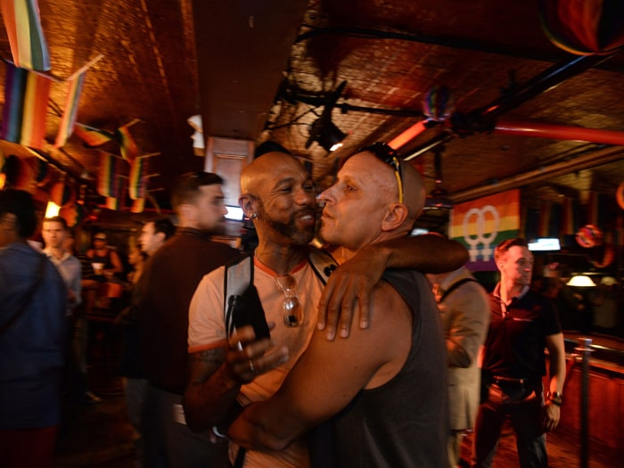 Patrons of the New York City's Stonewall Inn celebrated the news at an establishment that is legendary in the gay rights movement for riots that took place in 1969 when the gay community demonstrated against a police raid.