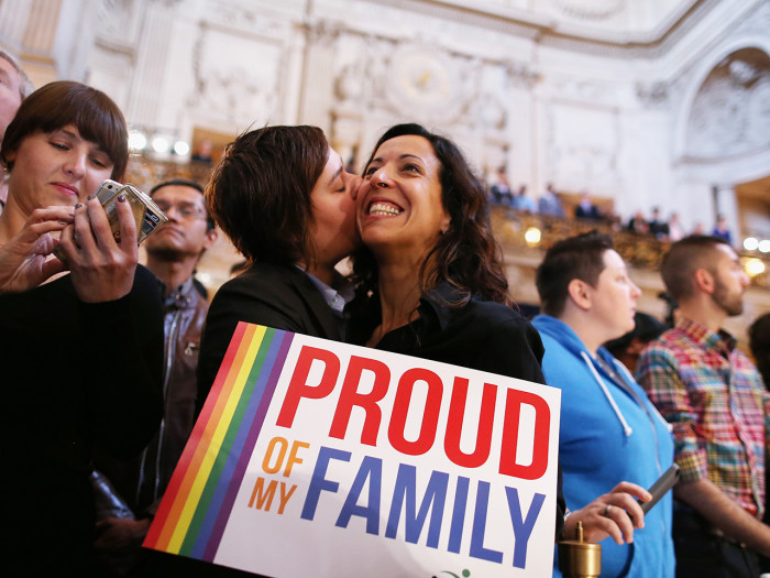 A couple at a rally in San Francisco celebrates the Supreme Court decisions, including one that will allow gay marriage to resume in California after it was banned in 2008.