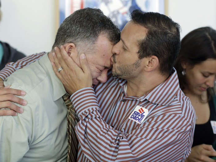 In addition to smiles and hugs among gay couples, there were also some tears like those from Jeff Ronci (left), who got a kiss from partner Juan Talavera at a party in Miami to watch the Supreme Court rulings.