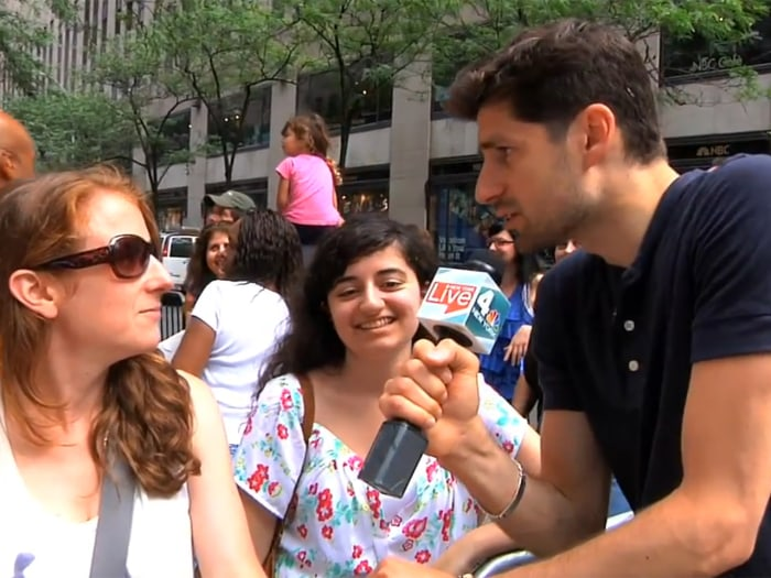 Image: Ben Aaron talks to concert-goers