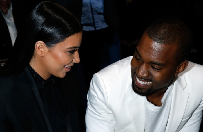 Kim Kardashian and Kanye West attend the Givenchy Fall/Winter 2013 Ready-to-Wear show as part of Paris Fashion Week on March 3 in Paris.