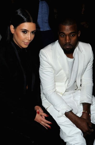 Cute or not? Kim Kardashian and Kanye West in Givenchy suits.