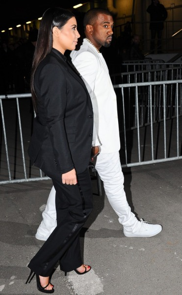 Kim Kardashian and Kanye West arrive at Givenchy's show in Paris.
