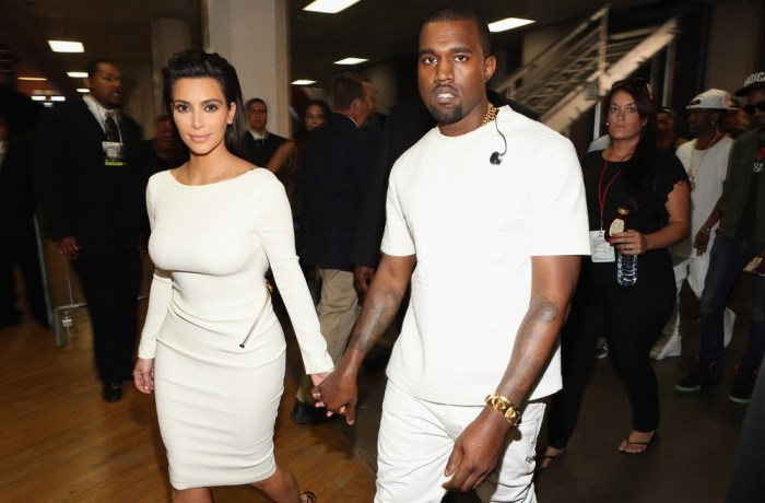 Bright white: Kim and Kanye wear matching outfits.