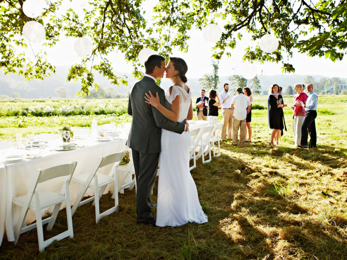 Are bridesmaids and groomsmen on their way out? More couples now opt for simpler weddings.