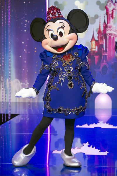 Minnie Mouse wearing a dress by Lanvin fashion house and designed by Alber Elbaz poses for the photographers before before a fashion show presenting t...