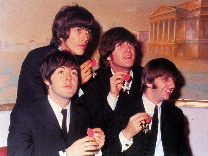 The Beatles (Paul McCartney, George Harrison, John Lennon and Ringo Starr)  show the medals making them members of the Order of the British Empire, presented to them by the Queen at Buckingham Palace on October 26, 1965.