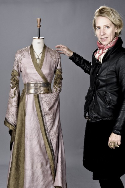 "Costume designer Michele Clapton, posing with one of her designs, is responsible for the lavish wardrobes on HBO's ""Game of Thrones."""