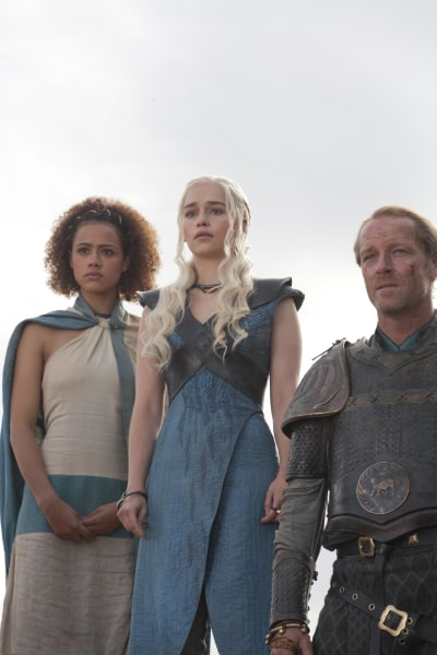 "Nathalie Emmanuel, Emilia Clarke and Iain Glen pose together in season 3 of ""Games of Thrones""."