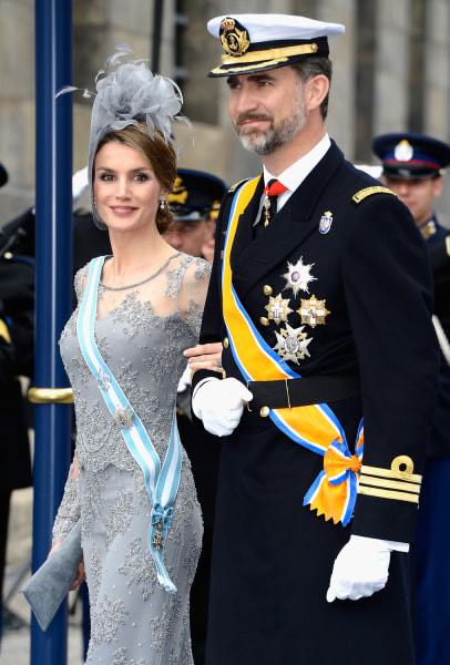 AMSTERDAM, NETHERLANDS - APRIL 30:  Princess Letizia of Spain and Prince Felipe of Spain depart the Nieuwe Kerk to return to the Royal Palace after th...