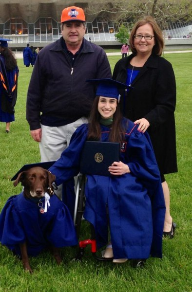 Grad Accepts Diploma With Cap And Gown Clad Service Dog