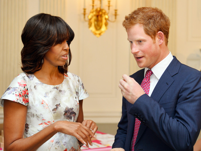 Prince Harry speaks with first lady Michelle Obama during the first day of his visit to the United States on May 9, 2013 in Washington, DC.