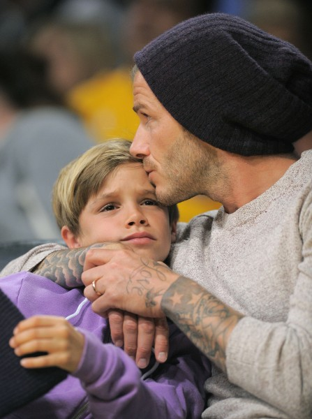 David has no problem being affectionate with his son, Romeo, at a Lakers game in Los Angeles.
