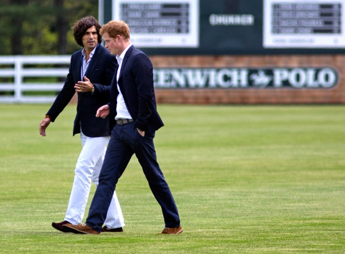 Prince Harry walks with polo player Nacho Figueras before the Sentebale Royal Salute Polo Cup charity match.
